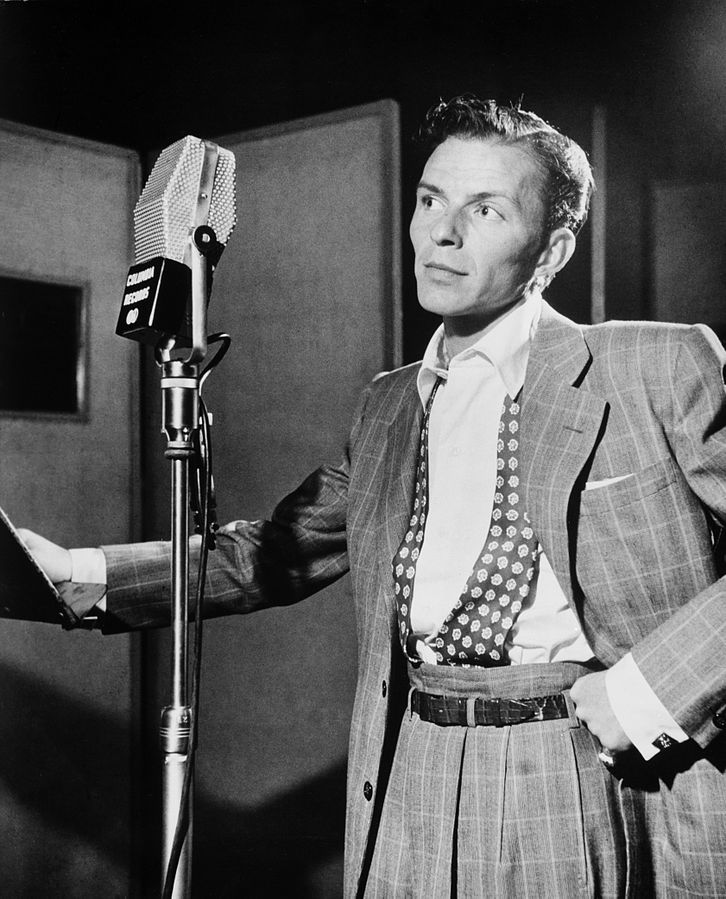 Frank Sinatra younger standing at microphone