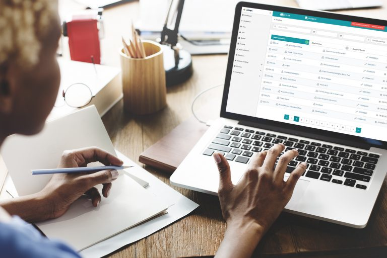 Woman using Joblogic's accounts integration feature