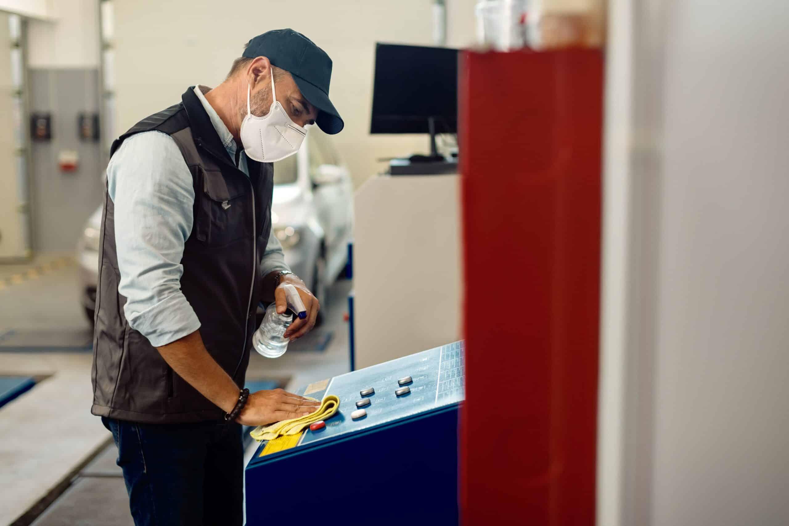 Maintenance worker cleaning equipment